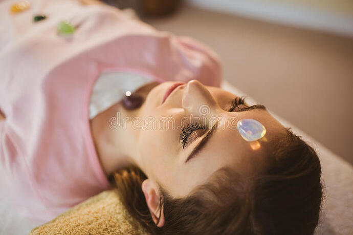 young-woman-crystal-healing-session-therapy-room-56814993